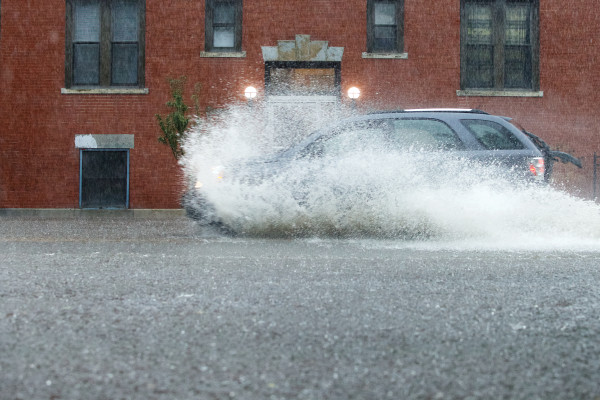 PORTLAND, MAINE -- 09/30/15 -- A car splashes through a flooded portion of Portland's Park Avenue on Wednesday. Troy R. Bennett | BDN