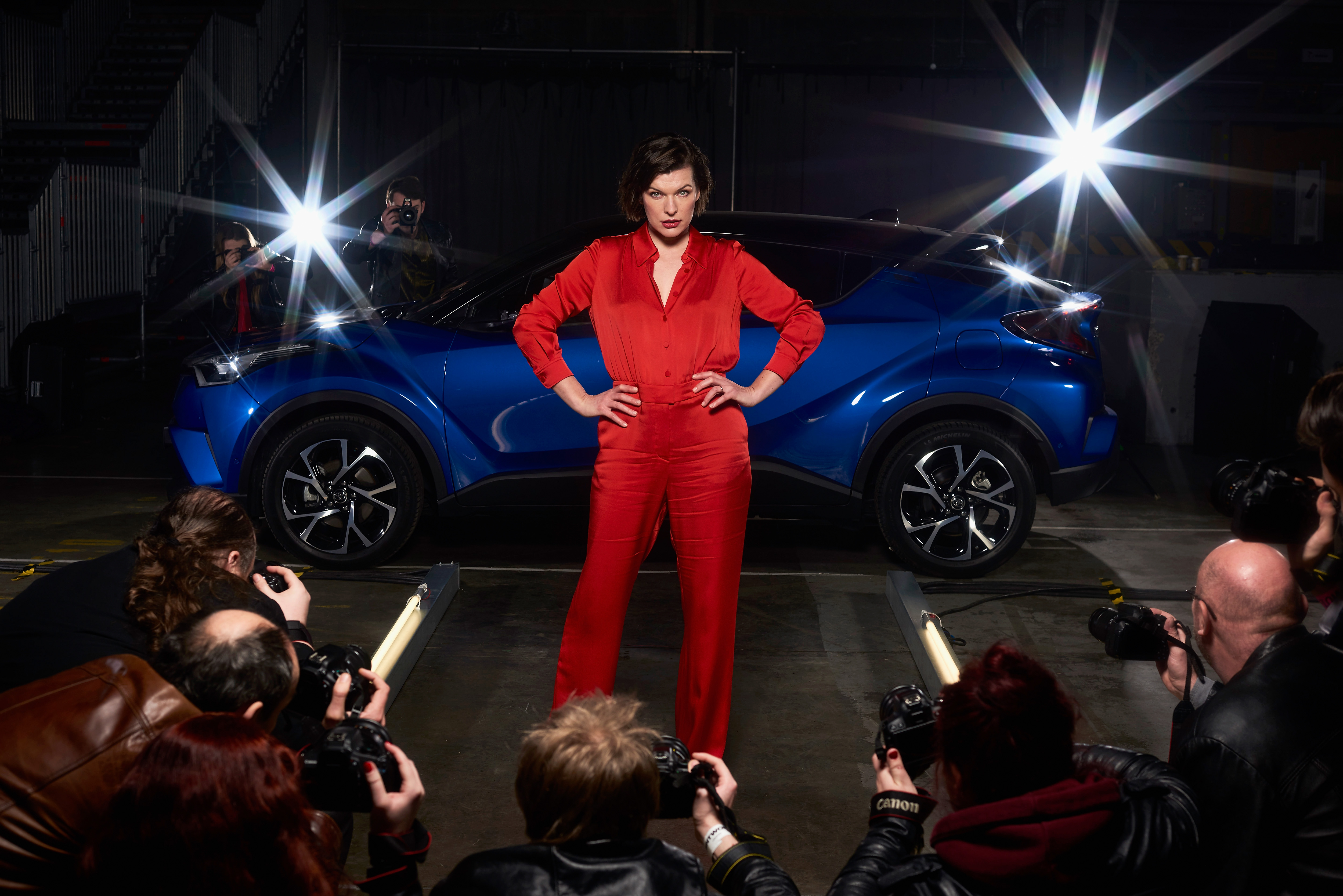 LONDON, ENGLAND - FEBRUARY 02: Milla Jovovich, actress and model, is captured stepping out of the new Toyota C-HR onto a catwalk at the world's first drive through immersive theatre experience on February 2, 2017 in London, England. 'The Night that Flows' saw 100 guests experience the immersive event, which brought to life the different features of the new Toyota C-HR. (Photo by Gareth Cattermole/Getty Images for Toyota) *** Local Caption *** Milla Jovovich