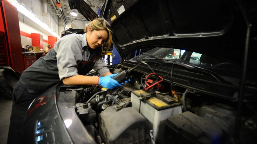 CMCC-CI-FEMALEAUTOMECHANICS CMCC..MAY 7th 2012.......pics of Eve Kobayashi 19 yrs..works on a car testing the battery.... Four female auto mechanics who work in Toyota dealership on Dufferin st at Lawrence ave...to go with Catherine Porter feature.........(COLIN MC CONNELL TORONTO STAR)